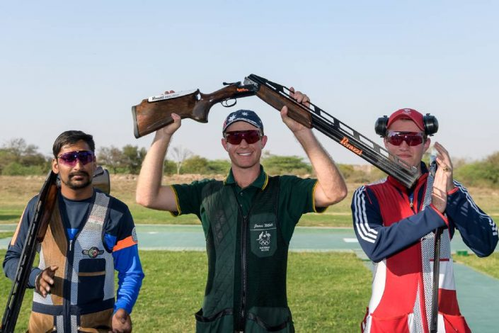 James Willett holds his gun aloft after claiming the opening ISSF World Cup event at New Delhi, India, this week.